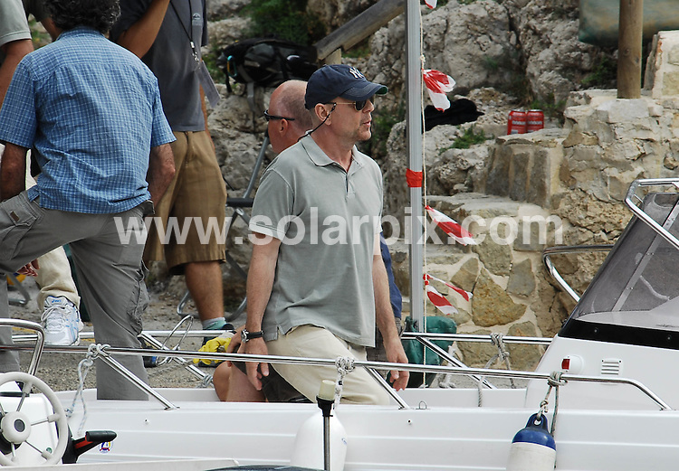 "**ALL ROUND PICTURES FROM SOLARPIX.COM**                                             **WORLDWIDE SYNDICATION RIGHTS EXCEPT SPAIN - NO SYNDICATION IN SPAIN**     .Caption:  Bruce Willis just started filming his latest action thriller film ""Cold Light of Day"" on the Spanish coast of Alicante.  .The film will see Willis play the role of a father that finds himself in the middle of a mysterious kidnapping. Henry Cavil plays a young Wall Street player (the son) who must find out the secrets of his family's disappearance. Sigourney Weaver will be another important presence in the film. ""Cold Light of Day"" is scheduled to be released sometime next year..                                                                             .This pic:  Bruce Willis                                                                                            ..JOB REF:12111       MPA       DATE:  16.09.2010                                                          **MUST CREDIT SOLARPIX.COM OR DOUBLE FEE WILL BE CHARGED**                                                                      **MUST AGREE FEE BEFORE ONLINE USAGE**                               **CALL US ON: +34 952 811 768 or LOW RATE FROM UK 0844 617 7637**"