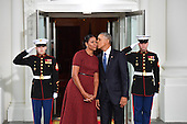 United States President Barack Obama (R) gives Michelle Obama a kiss as they wait for President-elect Donald Trump and wife Melania at the White House before the inauguration on January 20, 2017 in Washington, D.C.  Trump becomes the 45th President of the United States.      <br /> Credit: Kevin Dietsch / Pool via CNP