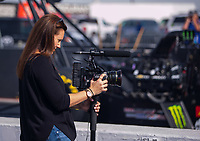 Feb 2, 2017; Chandler, AZ, USA; Former NHRA funny car driver Ashley Force Hood operates a camera during Nitro Spring Training preseason testing at Wild Horse Pass Motorsports Park. Mandatory Credit: Mark J. Rebilas-USA TODAY Sports