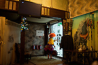 A birthday clown exits the restaurant at the Akbuzat Hippodrome in Ufa, Bashkortostan, Russia. The restaurant specializes in dishes featuring horse meat.