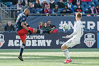 FOXBOROUGH, MA - MARCH 7: Andrew Farrell #2 of New England Revolution kicks the ball down field past Djordje Mihailovic #14 of Chicago Fire during a game between Chicago Fire and New England Revolution at Gillette Stadium on March 7, 2020 in Foxborough, Massachusetts.
