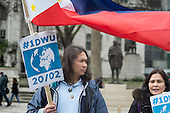 Filipino Domestic Workers, 1 Day Without Us flag mob in Parliament Square London in support of migrants