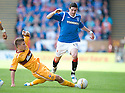 MOTHERWELL'S SHAUN HUTCHINSON CHALLENGES RANGERS' KYLE LAFFERTY