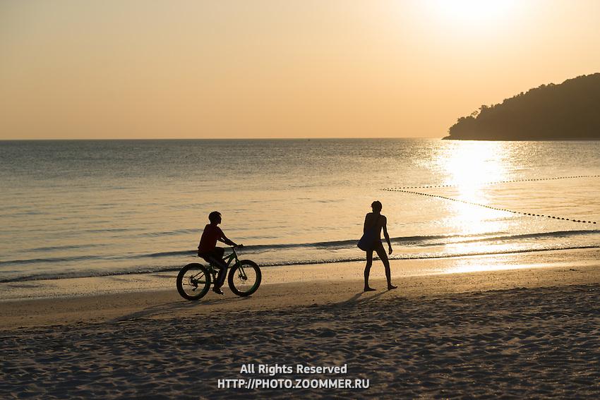 Cyclist Sihouette On Langkawi Cenang Beach, Malaysia