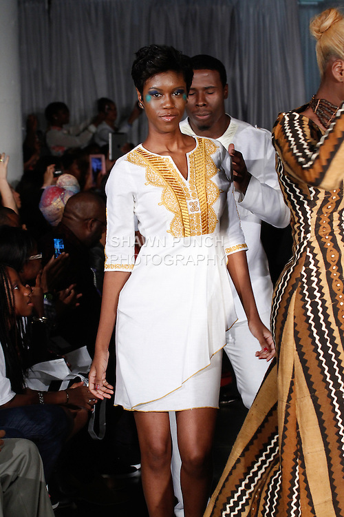 Models dance down runway in outfits from the Nallem Clothing Spring Summer 2014 collection by Gregory A. Kankoh, during Fashion Week Brooklyn Spring Summer 2014, in Brooklyn, New York on October 5, 2013.