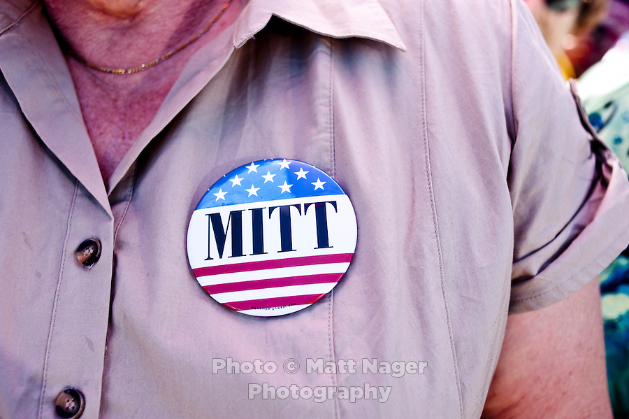 A supporter wears a Mitt Romney pin while waiting for presumptive Republican candidate for President Mitt Romney (cq) to speak to a crowd at K.P. Kauffman Company in Fort Lupton, Colorado, Wednesday, May 9, 2012. Romney was giving a recovering the economy stump speech.<br /> <br /> Photo by MATT NAGER