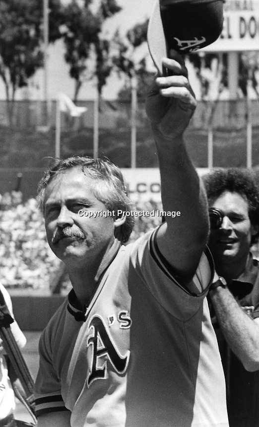 "Oakland Athletics pitcher Jim ""Catfish"" Hunter is honored by the A's at ceremony at the Oakland Alameda County Coliseum in 1991. (photo by Ron Riesterer)"