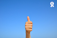 Man hand thumbs up, on blue sky (Licence this image exclusively with Getty: http://www.gettyimages.com/detail/103301316 )