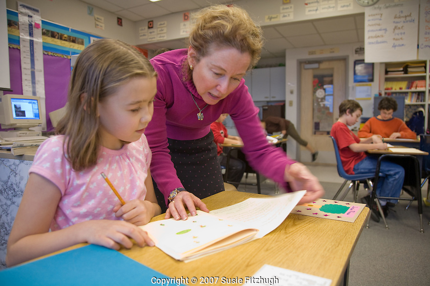 Clare Meeker works with  Jan Dalbey's 5th grade class at West Woodland ES, creating books the students have written and illustrated themselves. [Writers in the Schools]