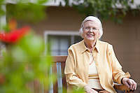 Senior Woman Sitting on a Bench Enjoying the Outdoors