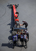 Sep 17, 2016; Concord, NC, USA; Crew members with NHRA top fuel driver Chris Karamesines during qualifying for the Carolina Nationals at zMax Dragway. Mandatory Credit: Mark J. Rebilas-USA TODAY Sports
