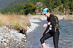 NELSON LAKES, NEW ZEALAND - APRIL 18:  Natalie Colville crosses the Travers River during the 2015 Alpine Lodge Loop The Lake trail run at Lake Rotoiti on April 18 16, 2015 in Nelson, New Zealand. (Photo by Marc Palmano/Shuttersport Limited)
