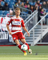 FC Dallas midfielder Michel Garbini (31) passes the ball. .  In a Major League Soccer (MLS) match, FC Dallas (red) defeated the New England Revolution (blue), 1-0, at Gillette Stadium on March 30, 2013.