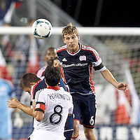 New England Revolution midfielder Scott Caldwell (6) heads the ball.  In a Major League Soccer (MLS) match, the New England Revolution (blue) defeated D.C. United (white), 2-1, at Gillette Stadium on September 21, 2013.