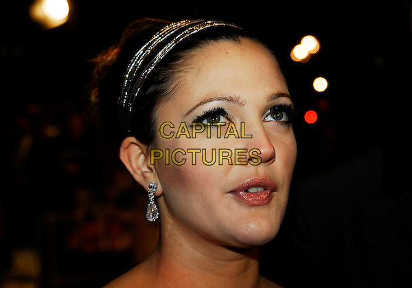 "DREW BARRYMORE.At the UK Film Premiere of ""Music & Lyrics"",.Odeon Leicester Square, London, England,.February 5th 2007..portrait headshot hairband hair band earrings .CAP/IA.©Ian Allis/Capital Pictures"