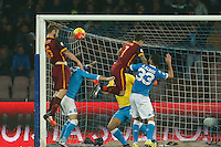 AS Roma's Daniele De Rossi  heads the ball  during the  italian serie a soccer match,between SSC Napoli and AS Roma       at  the San  Paolo   stadium in Naples  Italy ,December 13, 2015