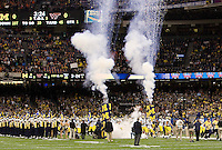 Michigan football players run on the field before Sugar Bowl game against Virginia Tech at Mercedes-Benz SuperDome in New Orleans, Louisiana on January 3rd, 2012.  Michigan defeated Virginia Tech, 23-20 in first overtime.