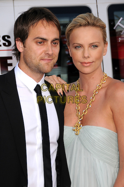 """STUART TOWNSEND & CHARLIZE THERON.""""Hancock"""" Los Angeles Premiere at Grauman's Chinese Theatre, Hollywood, California, USA..June 30th, 2008.half length black tie suit white shirt pale blue strapless dress gold necklace  couple .CAP/ADM/BP.©Byron Purvis/AdMedia/Capital Pictures."""