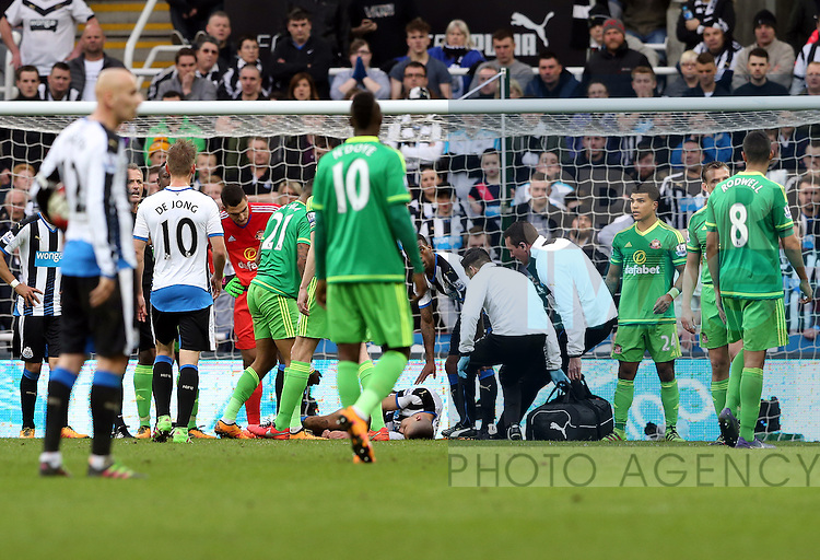Newcastle United's Aleksandar Mitrovic, center bottom, lies injured on the pitch during the Barclays Premier League match at St James' Park Stadium. Photo credit should read: Scott Heppell/Sportimage