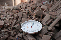 A damaged clock that indicated 12:02, lays in the rubble of a collapsed house Changu village, Bhaktapur, outside of Kathmandu, Nepal.  The 2015 Nepal earthquake which killed more than 7,000 people and injured more than twice as many, occurred at 11:56 NST on 25 April, with a moment magnitude 7.8. . May 05, 2015