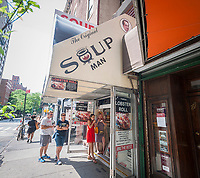 """A branch of the Soupman chain of soup take-out restaurants in Midtown in New York on Wednesday, June 14, 2017. Soupman Inc., which licenses the intellectual property of Al Yeganeh, the """"Soup Nazi"""" from the Seinfeld show,  filed for bankruptcy protection citing among other reasons the liabilities incurred when the former CFO was indicted for allegedly failing to pay income tax, Medicare and FICA for their employees.  (© Richard B. Levine)"""