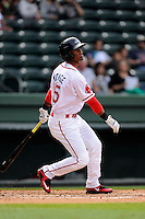 Center fielder Joseph Monge (15) of the Greenville Drive bats in a game against the Asheville Tourists on Friday, April 24, 2015, at Fluor Field at the West End in Greenville, South Carolina. Greenville won, 5-2. (Tom Priddy/Four Seam Images)