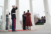 United States President Barack Obama and First Lady Michelle Obama watch as President-elect Donald Trump's motorcade arrives at the White House prior to his inauguration in Washington, D.C. on January 20, 2017. Later today Donald Trump will be sworn-in as the 45th President. <br /> Credit: Kevin Dietsch / Pool via CNP
