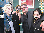 A group of revelers all with mustaches pose for a photograph outside a popular restaurant in the North Beach district of San Francisco. Meli Brown (fashion designer), William Vahan (fashion designer) Conan Soranno (photographer) and Mischa Romo (model).