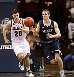 SIOUX FALLS, SD: MARCH 22: Ben Sonnenfeld  #3 of Colorado Mines dribbles up the court trailed by Bellarmine defender George Knott #20 during the Men's Division II Basketball Championship Tournament on March 22, 2017 at the Sanford Pentagon in Sioux Falls, SD. (Photo by Dick Carlson/Inertia)