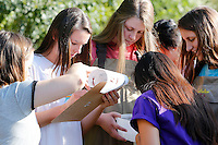 NWA Democrat-Gazette/DAVID GOTTSCHALK  Kambre Whisenhunt (second from left),  a Fayetteville High School student in the Outdoor Education Class, records findings Wednesday, September 16, 2015 collected in a  kick and pick net in Clear Creek in Johnson. The class, taught by Laura Ring, assisted by the Washington County Extension Service was assessing the water quality based on the biodiversity benthic organisms.