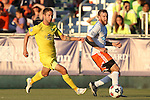 01 August 2015: Carolina's Connor Tobin (right) clears the ball away from Tampa Bay's Brian Shriver (left). The Carolina RailHawks hosted the Tampa Bay Rowdies FC at WakeMed Stadium in Cary, North Carolina in a North American Soccer League 2015 Fall Season match. The game ended in a 1-1 tie.
