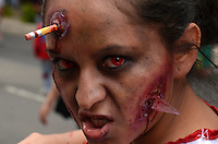 D.F. Mexico, November 23. 2013. A woman attends a rally while  Thousands of people dressed as zombies take part in a march from the plaza of the three cultures on the Paseo de la Reforma Avenue to the Angel of Independence.  VIEWpress/Miguel Angel Pantaleon