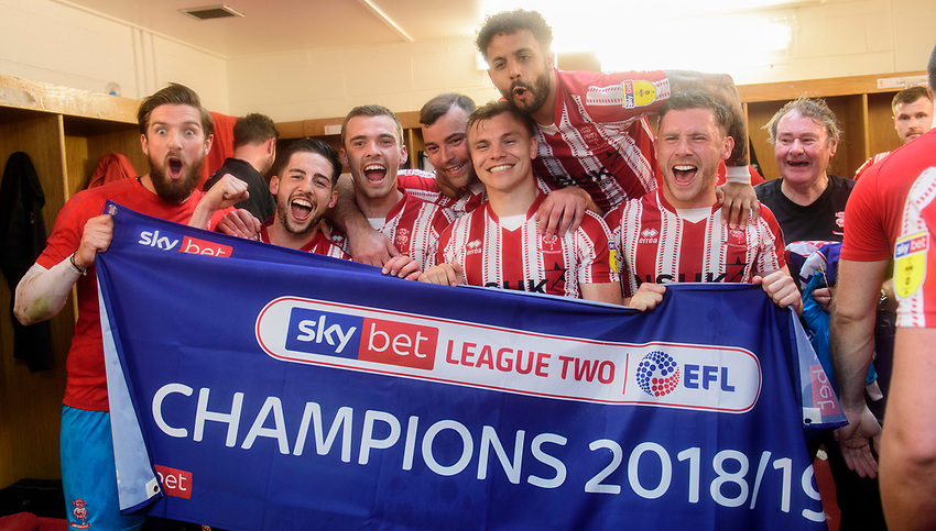 Lincoln City players, from left, Josh Vickers, Tom Pett, Harry Toffolo, Matt Rhead, Harry Anderson, Bruno Andrade, and Shay McCartan celebrate in the changing room after winning the league<br /> <br /> Photographer Chris Vaughan/CameraSport<br /> <br /> The EFL Sky Bet League Two - Lincoln City v Tranmere Rovers - Monday 22nd April 2019 - Sincil Bank - Lincoln<br /> <br /> World Copyright © 2019 CameraSport. All rights reserved. 43 Linden Ave. Countesthorpe. Leicester. England. LE8 5PG - Tel: +44 (0) 116 277 4147 - admin@camerasport.com - www.camerasport.com