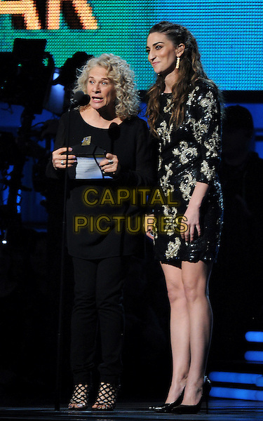 LOS ANGELES, CA - JANUARY 26 : (L-R) Carole King and Sara Bareilles speak onstage at The 56th Annual GRAMMY Awards at Staples Center on January 26, 2014 in Los Angeles, California.<br /> CAP/MPI/PG<br /> &copy;PGFMicelotta/MediaPunch/Capital Pictures