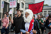 UK Uncut ad Disabled People Against the Cuts march to the Royal Courts of Justice in protest at proposed cuts to Legal Aid.