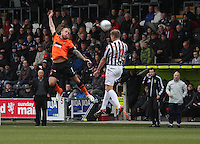 Marc McAusland wins the header from an acrobatic Johnny Russell in the St Mirren v Dundee United Clydesdale Bank Scottish Premier League match played at St Mirren Park, Paisley on 27.10.12.