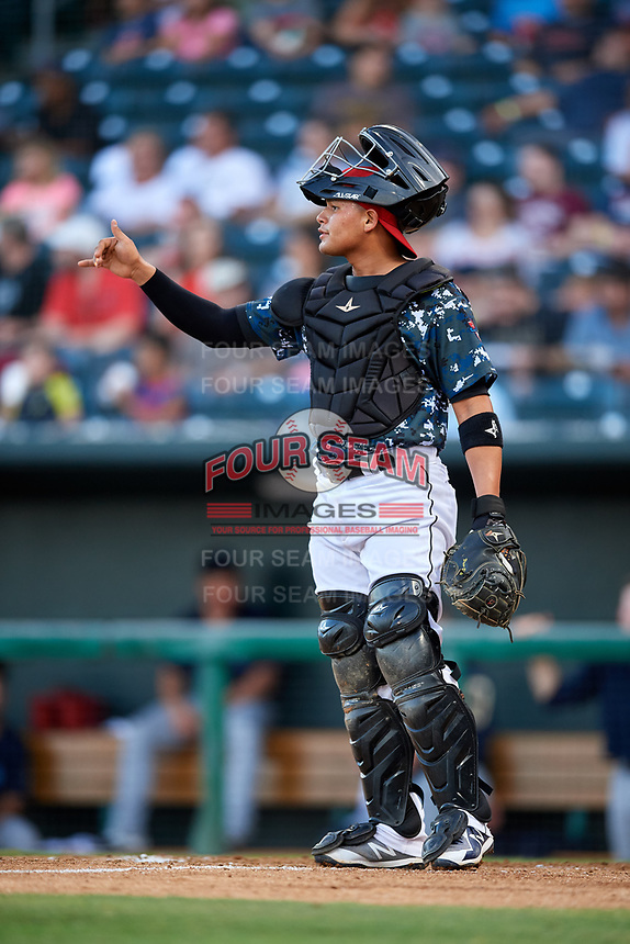 Jacksonville Jumbo Shrimp catcher Rodrigo Vigil (6) directs the infield defense during a game against the Mobile BayBears on April 14, 2018 at Baseball Grounds of Jacksonville in Jacksonville, Florida.  Mobile defeated Jacksonville 13-3.  (Mike Janes/Four Seam Images)