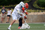 29 April 2016: North Carolina's Luke Goldstock (left) challenges Syracuse's goaltender Evan Molloy (13) for a loose ball. The University of North Carolina Tar Heels played the Syracuse University Orange at Fifth Third Bank Stadium in Kennesaw, Georgia in a 2016 Atlantic Coast Conference Men's Lacrosse Tournament semifinal match.