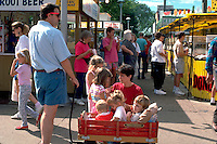 Family talking at State Fair and traveling by wagon ages 1 through 6.  St Paul Minnesota USA