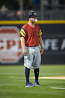 Toledo Mud Hens manager Doug Mientkiewicz (16) blows a bubble while coaching third base during the game against the Charlotte Knights at BB&T BallPark on April 23, 2019 in Charlotte, North Carolina. The Knights defeated the Mud Hens 11-9 in 10 innings. (Brian Westerholt/Four Seam Images)