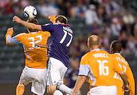 Houston Dynamo defender Bobby Boswell (32) and CD Chivas USA forward Justin Braun (17) battle in the air. The Houston Dynamo defeated CD Chivas USA 2-0 at Home Depot Center stadium in Carson, California on Saturday May 8, 2010.  .