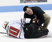 Steve Quailer (NU - 10), Steve Clark (NU - Trainer) - The Northeastern University Huskies defeated the St. Thomas Tommies 7-5 in their exhibition match on Saturday, October 3, 2009, at Matthews Arena in Boston, Massachusetts.
