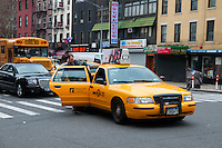 Man gets in a taxi on a crossing on Manhattan