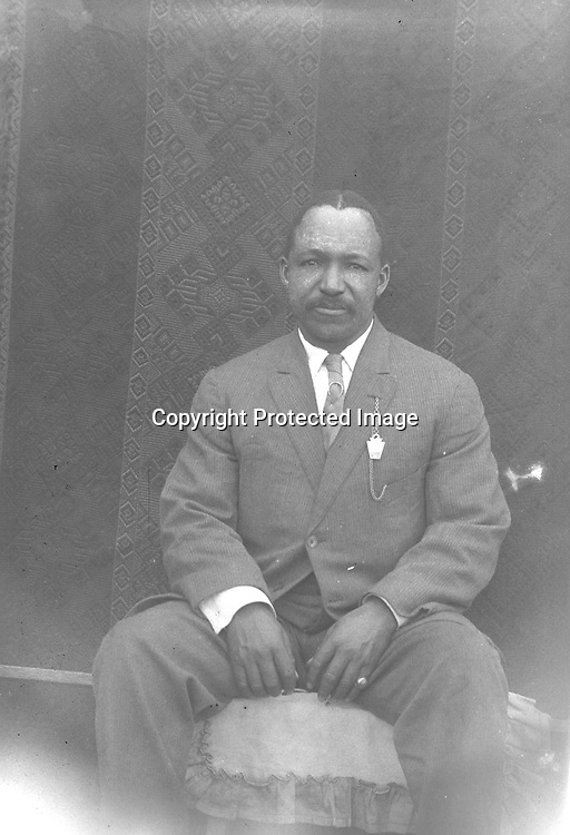 PRINCE HALL MASON. Lincoln's African American community had an organized Masonic lodge by the 1880s, and various Masonic organizations remained active among both men and women throughout the 20th century. This man prominently displays a Masonic emblem.<br /> <br /> Photographs taken on black and white glass negatives by African American photographer(s) John Johnson and Earl McWilliams from 1910 to 1925 in Lincoln, Nebraska. Douglas Keister has 280 5x7 glass negatives taken by these photographers. Larger scans available on request.