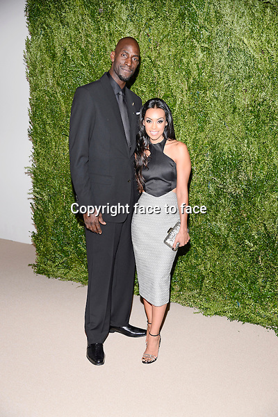 NBA's Kevin Garnett and Guest pictured at the CFDA and Vogue 2013 Fashion Fund Finalists Celebration at Spring Studios on November 11, 2013 in New York City.<br />