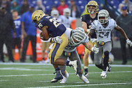 Annapolis, MD - September 8, 2018: Navy Midshipmen running back Tazh Maloy (25) is tackled by Memphis Tigers linebacker Austin Hall (25) for no gain during game between Memphis and Navy at  Navy-Marine Corps Memorial Stadium in Annapolis, MD. (Photo by Phillip Peters/Media Images International)
