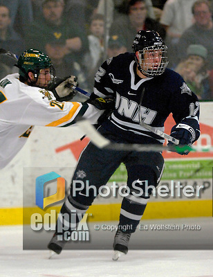 """5 January 2007: University of New Hampshire forward Bobby Butler (12) from Marlborough, MA, in action against the University of Vermont Catamounts at Gutterson Fieldhouse in Burlington, Vermont. The UNH Wildcats defeated Vermont 7-1 in front of a record setting 48th consecutive sellout at """"the Gut""""...Mandatory Photo Credit: Ed Wolfstein Photo.<br />"""