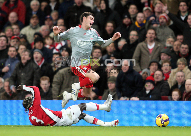 PICTURE BY JEREMY RATA/SWPIX.COM. Barclays Premier League 2008/9 - Arsenal v Liverpool- Emirates Stadium, London, England. 21st December 2008. Arsenal's  Bacaray Sagna brings down Liverpool's Albert Riera..Copyright - Simon Wilkinson - 07811267706