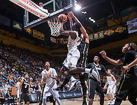 California's Jabari Bird tries to shoot for the basket but was defended by Colorado's Josh Scott game at Haas Pavilion in Berkeley, California on March 8th, 2014. California defeated Colorado 66 - 65