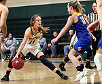 WATERBURY CT. 16 February 2018-021619SV18-#11 Hannah Brown of Holy Cross High sets up a play as #10 Megan Condo of Seymour High defends during the NVL girl&rsquo;s basketball tournament in Waterbury Saturday.<br /> Steven Valenti Republican-American